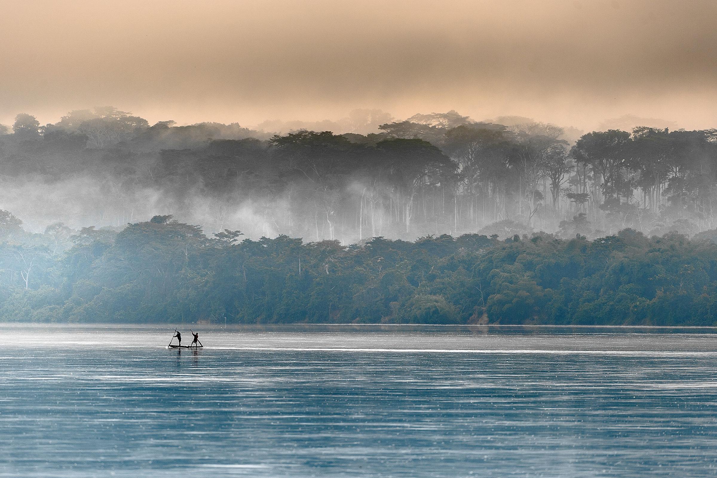 Sangha River. Morning fog on the African river Sangha. Congo.