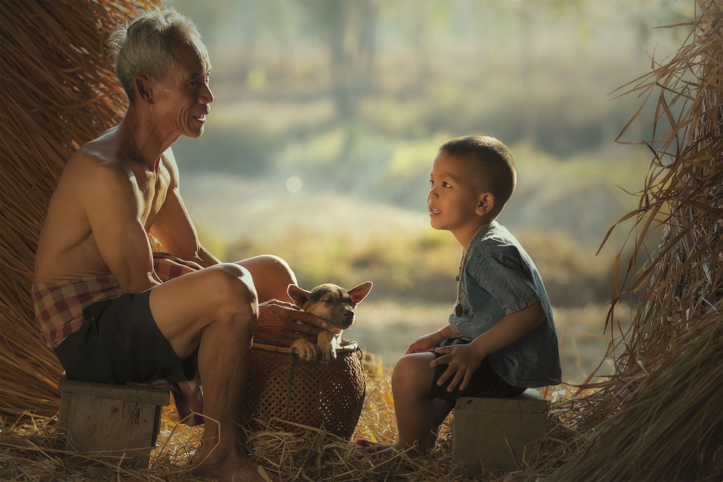 Man sitting talking with young boy