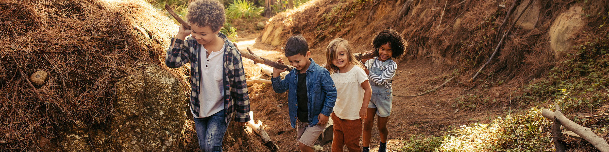 2019 AMI Annual Report Cover Children Exploring Outdoors