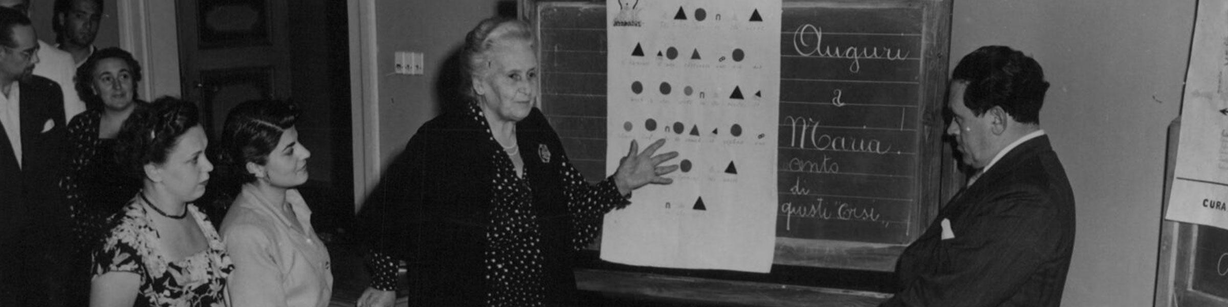 Maria and Mario Montessori discussing grammar symbols at the 1950 Perugia training course