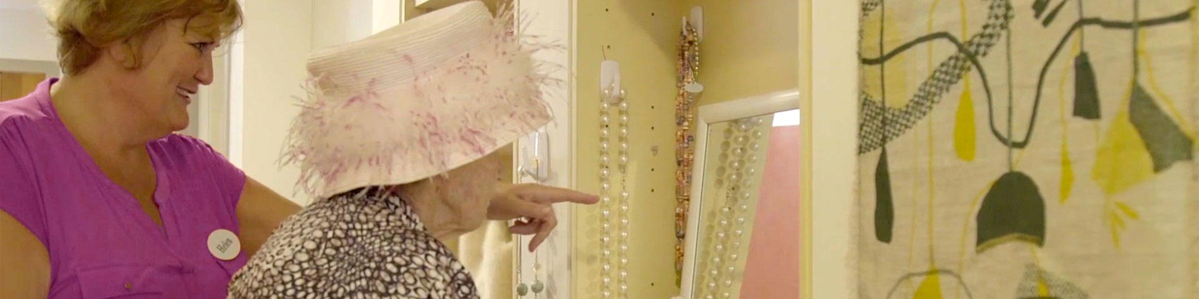 Elderly woman in Montessori environment