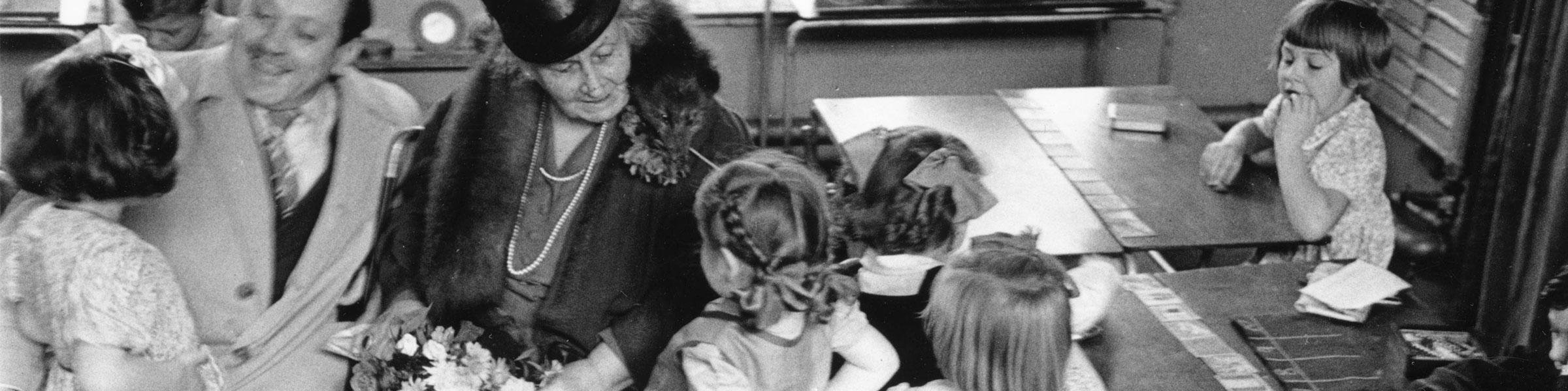 Maria and Mario Montessori with children