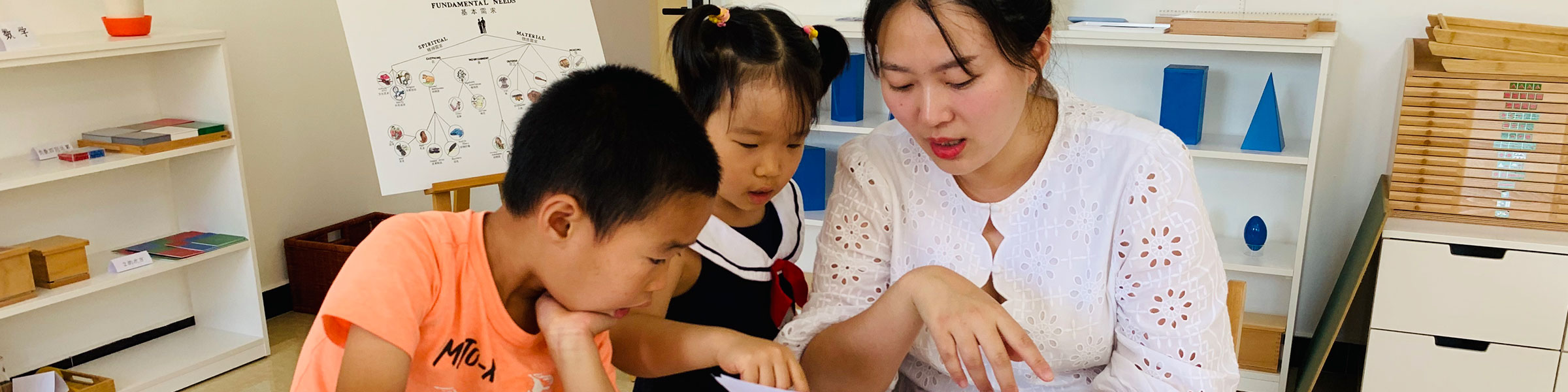 Montessori teacher and children