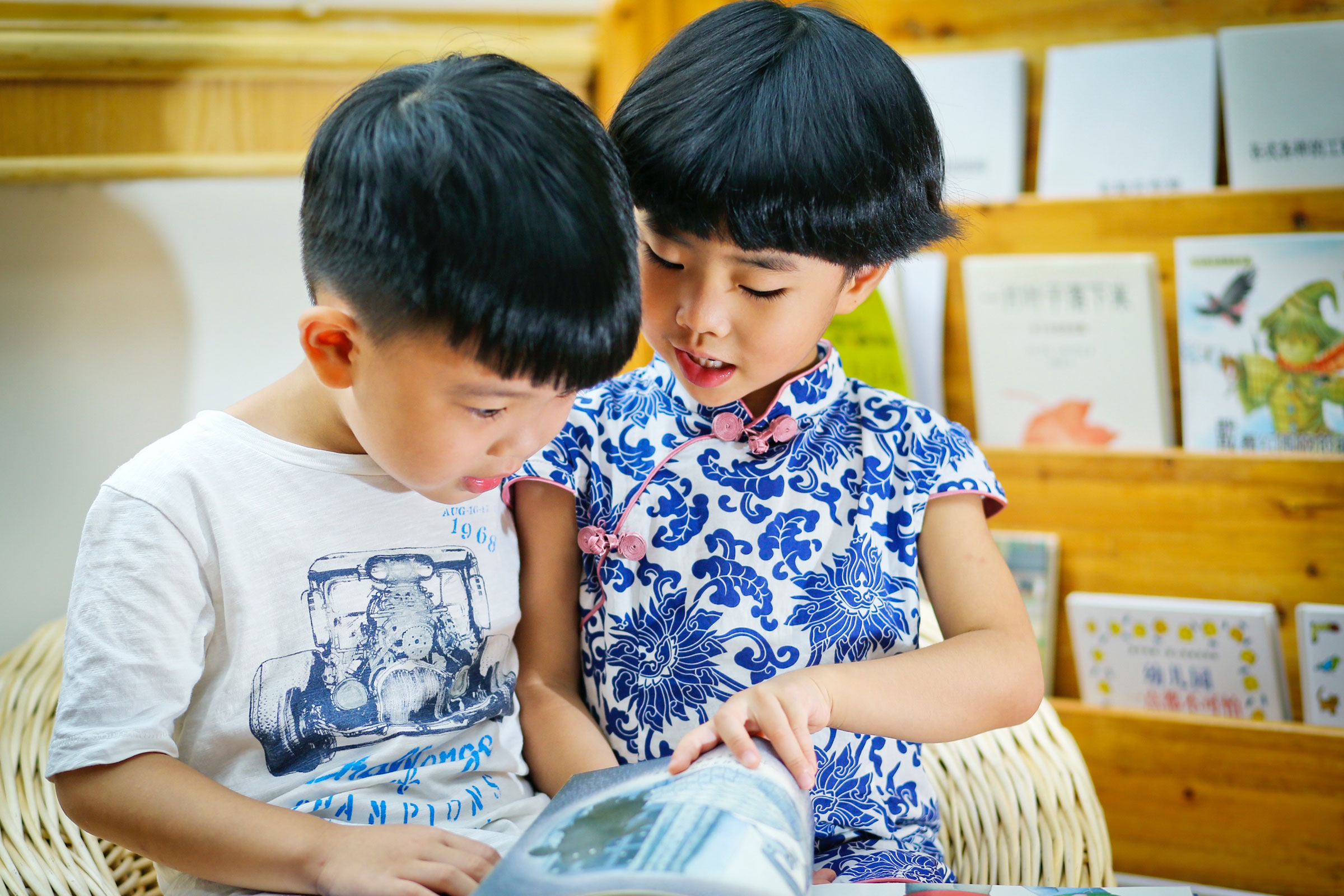 Two children reading a book together