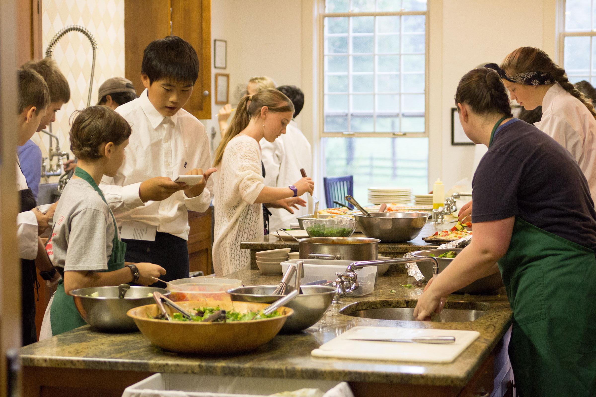 Montessori Adolescent class preparing food in kitchen