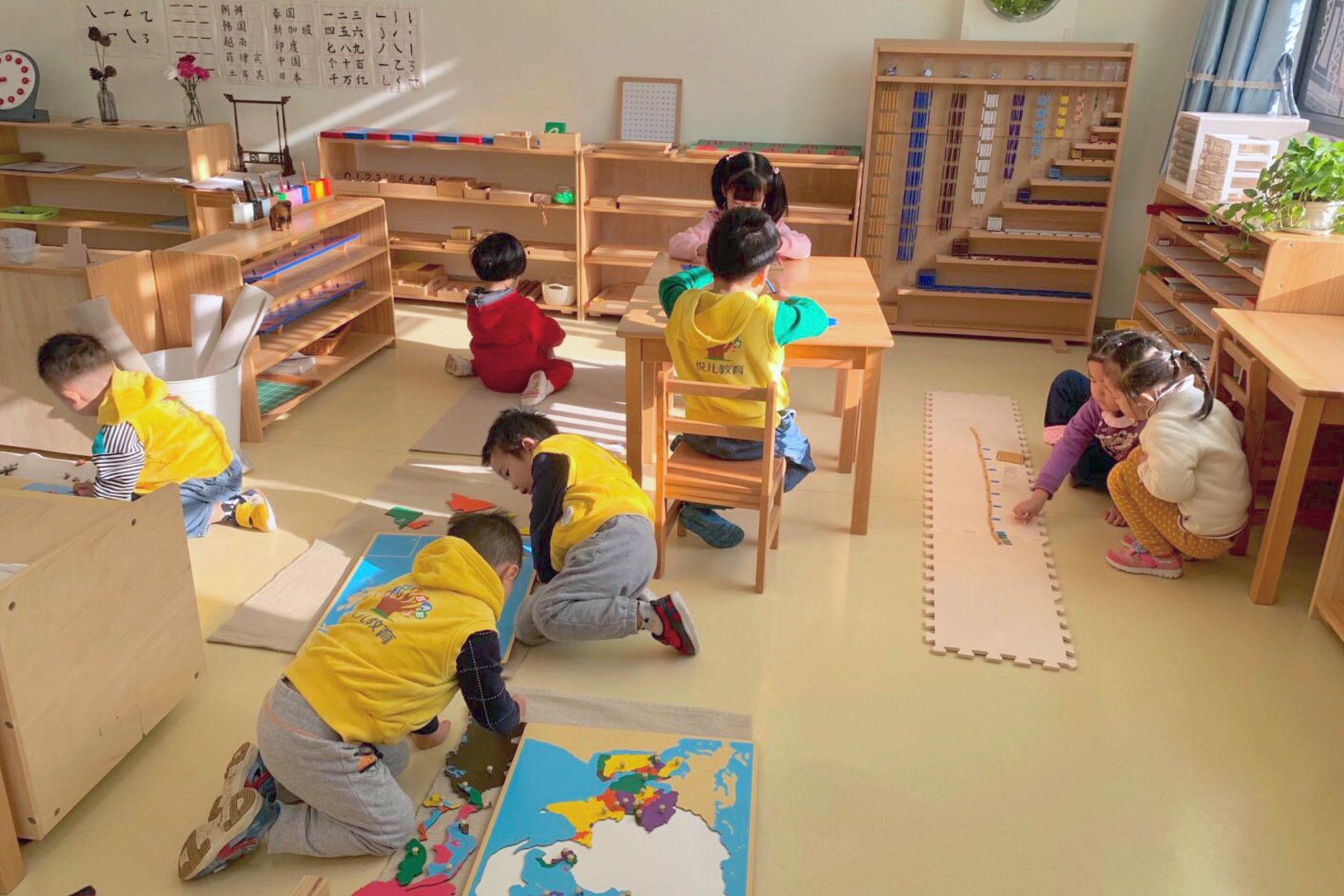 Children working in a Montessori classroom