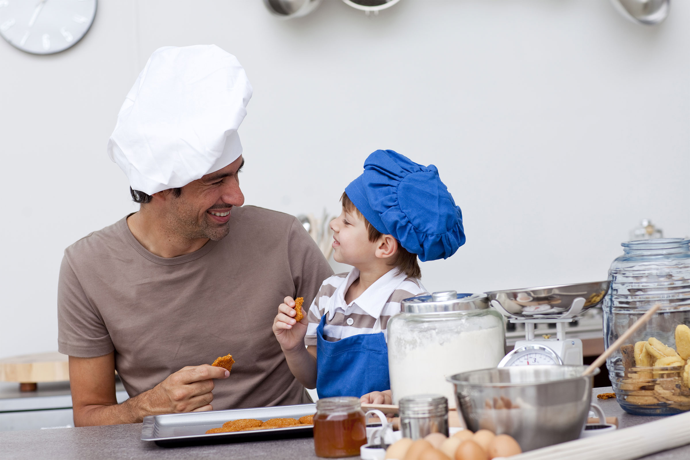 Parent and child cooking together
