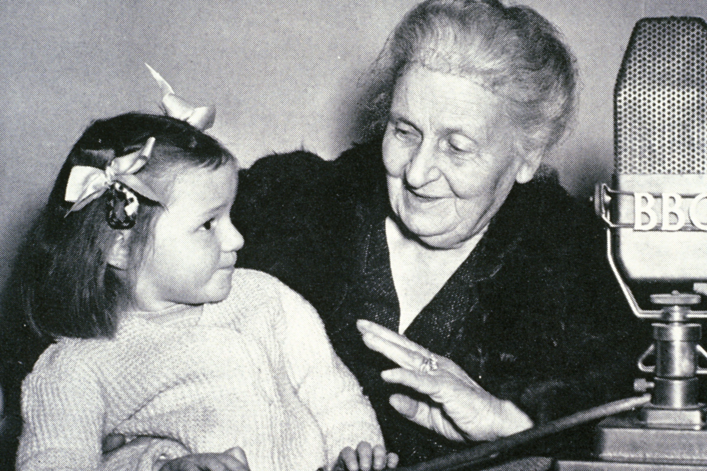 Maria Montessori with child during BBC radio broadcast