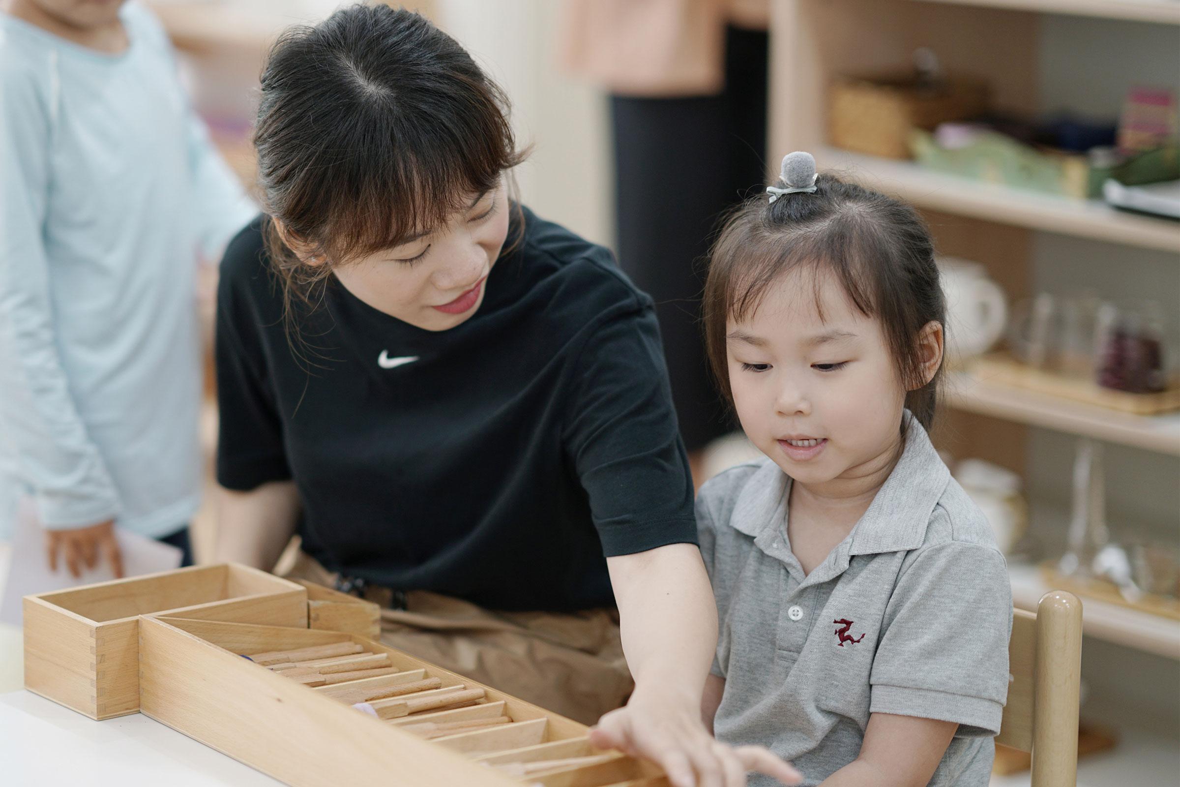 Montessori teacher and child