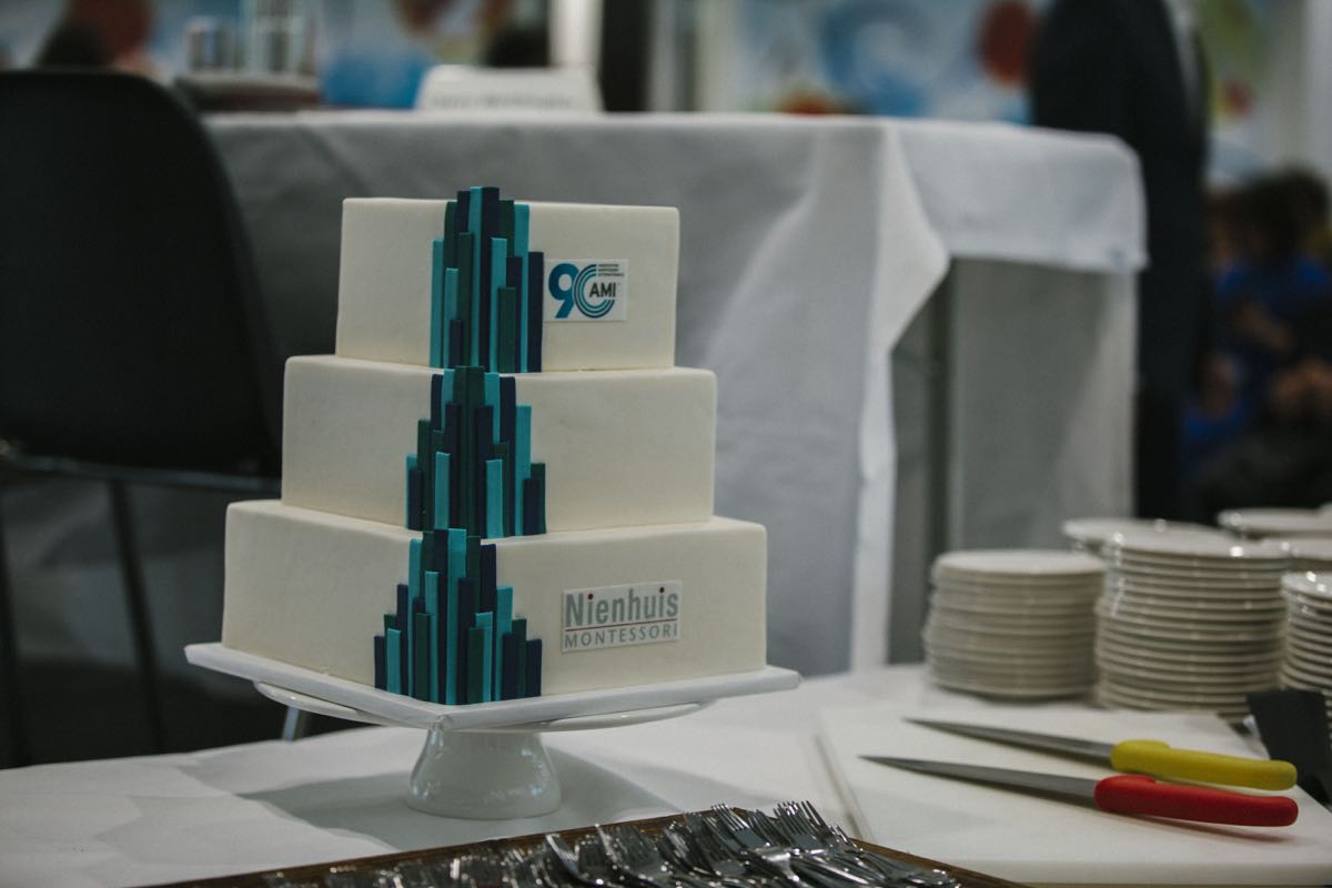 This wonderful cake was brought onto stage to mark AMI's 90 years.  Nienhuis Montessori, who share our foundation date (1929) sponsored the occasion. The cake was cut by three of Maria Montessori's great grandchildren, a representative from Nienhuis, the AMI Board, Young Professionals and staff.