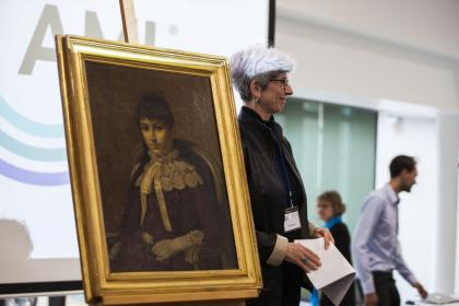 Helen Henny proudly presented the picturesque portrait of a young Maria Montessori to the AGM audience, giving a brief talk on her family's heritage and how she came into its possession.