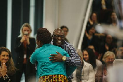Hillary Korir, Head of the Montessori Fund for Kenya, receives congratulations from Dani Mhenga, the course assistant on the Tanzanian course.