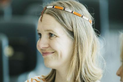 AMI Staff Fay Hendriksen watches a workshop whilst wearing a gift from the Samburu community in Kenya.